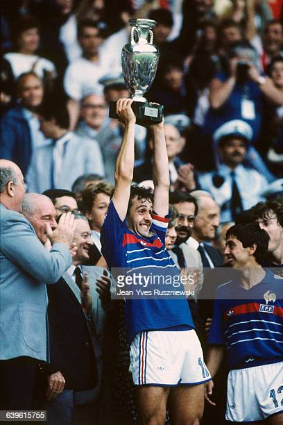 Michel Platini, captain of the French soccer team, holds the European Cup trophy after his team defeated Spain 2-0 in the final of the 1984 UEFA Euro.