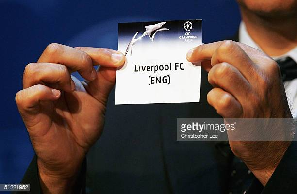 Michel Platini draws out Liverpool during the UEFA Champions League Draw for the first stage of the Season 2004/05 at the Grimaldi Forum on August 26...