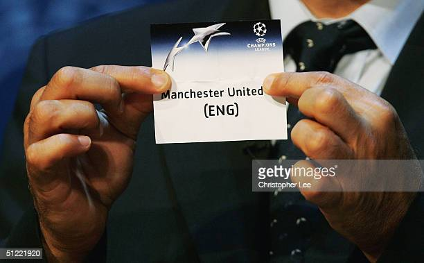 Michel Platini draws out Manchester United during the UEFA Champions League Draw for the first stage of the Season 2004/05 at the Grimaldi Forum on...