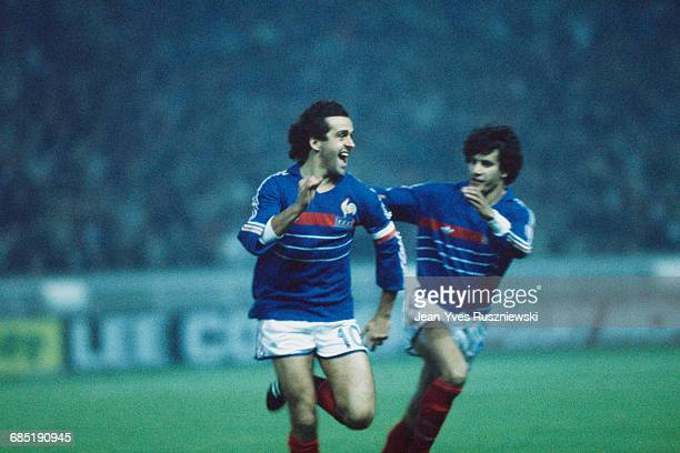 Michel Platini from France celebrates scoring a goal with William Ayache during a first round match of the European Championship against Denmark....