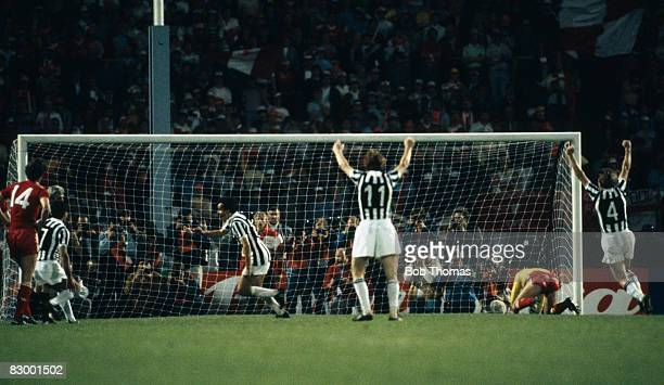 Michel Platini has beaten Liverpool goalkeeper Bruce Grobbelaar with a penalty kick to win the European Cup Final 10 for Juventus at the Heysel...