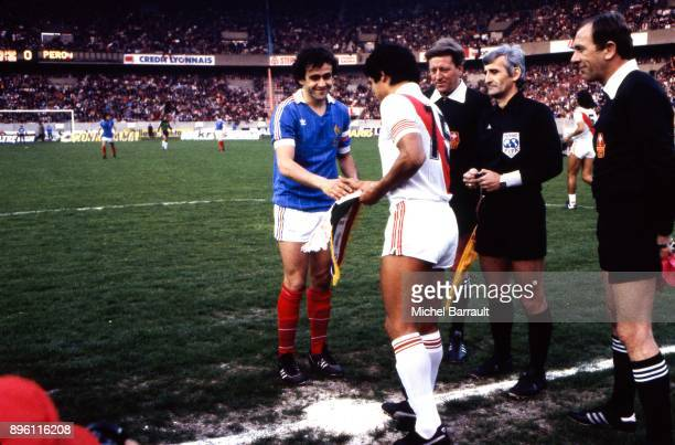 Michel Platini of France and Ruben Toribio Diaz of Peru during the International Friendly match between France and Peru at Parc des Princes in Paris...