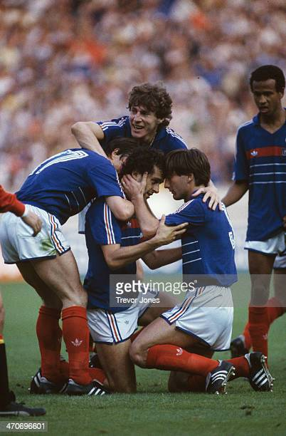 Michel Platini of France celebrates his goal with teamates during the UEFA European Championships 1984 Final match between France and Spain held on...
