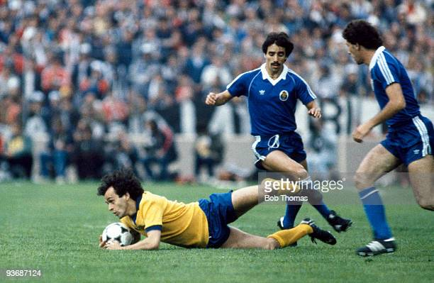 Michel Platini of Juventus is tackled by Antonio Viera of Porto during the Juventus v Porto European Cup Winners Cup Final played at the St Jakob...