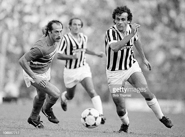Michel Platini of Juventus moves away from Franceso Casagrade during their Serie A match at the Stadio Luigi Ferraris in Genoa 12th September 1982...