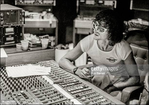 Michel Polnareff at a mixing desk in the control room of a recording studio London 1976