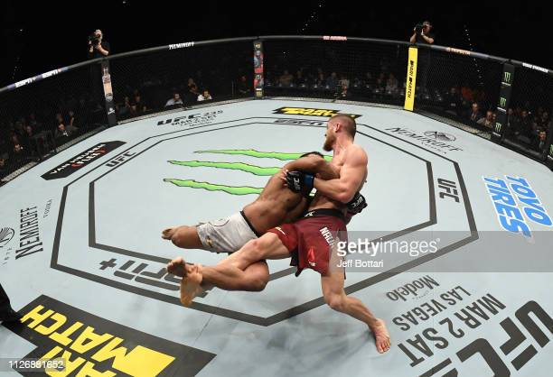 Michel Prazeres of Brazil attempts to take down Ismail Naurdiev of Austria in their welterweight bout during the UFC Fight Night event at O2 Arena on...