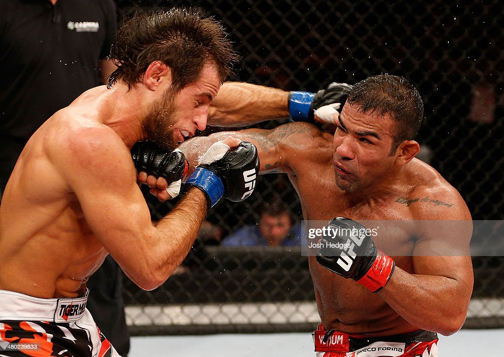 Michel Prazeres punches Maribek Taisumov in their lightweight bout during the UFC Fight Night event at Ginasio Nelio Dias on March 23, 2014 in Natal, Brazil.