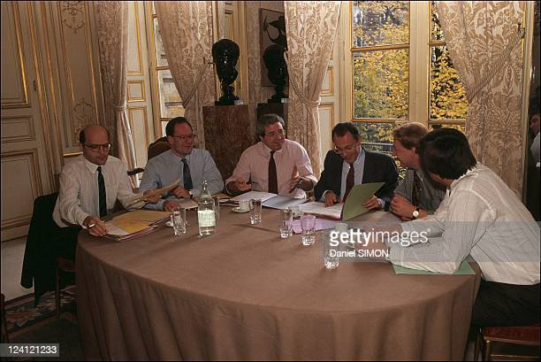 Michel Rocard and his collaborators at Matignon in Paris France on November 19 1990 Alain Prestat Yves Colmou Jean Paul Huchon Michel Rocard Guy...