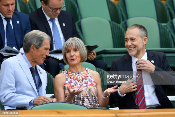 Michel Roux Jr his wife Giselle and Anthony Henman look on from the centre court royal box on day four of the Wimbledon Lawn Tennis Championships at...