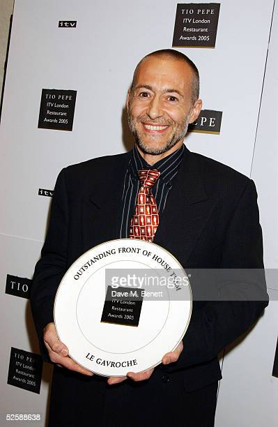 Michel Roux poses with the award for Outstanding Front of House Team at The Tio Pepe/Carlton London Restaurant Awards 2005 at the Grosvenor House...