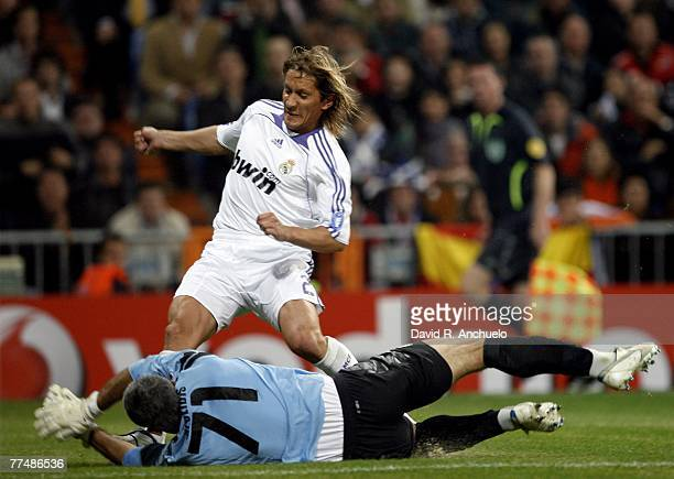 Michel Salgado fo Real Madrid shoots on goal during the Champions League match between Real Madrid and Olympiakos at the Santiago Bernabeu stadium on...