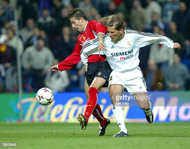 Michel Salgado of Real Madrid and Fernandez Luis Garcia of Murcia battle for control of the ball during a Spanish Primera Liga match between Real...