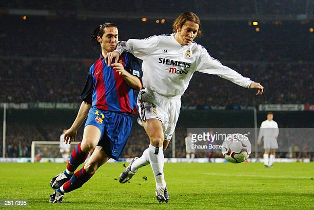 Michel Salgado of Real Madrid holds off Luis Garcia of Barcelona during the Spanish Primera Liga match between Barcelona and Real Madrid on December...