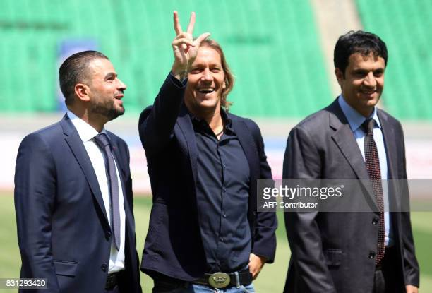 Michel Salgado retired Spanish footballer gestures to supporters at the stadium in Basra on August 14 2017 ahead of a match between International...