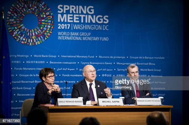 Michel Sapin France's finance minister center speaks as Odile RenaudBasso director general of the French treasury left and Francois Villeroy de...