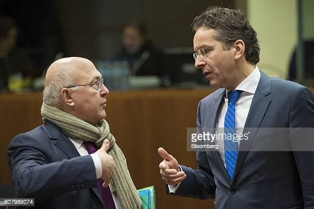 Michel Sapin France's finance minister left speaks with Jeroen Dijsselbloem Dutch finance minister and head of the group of euroarea finance...