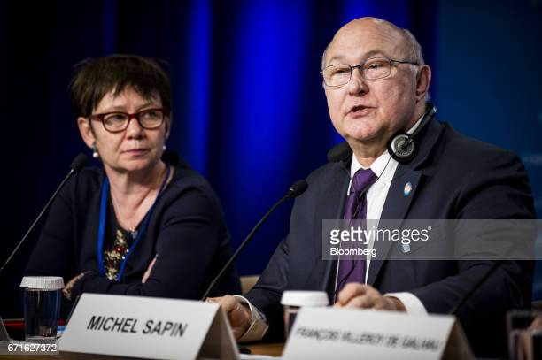Michel Sapin France's finance minister right speaks as Odile RenaudBasso director general of the French treasury listens during a press conference at...