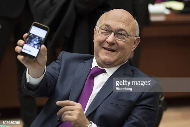 Michel Sapin France's finance minister shows a photo he took on his Apple Inc smartphone ahead of an Ecofin meeting of European Union finance...