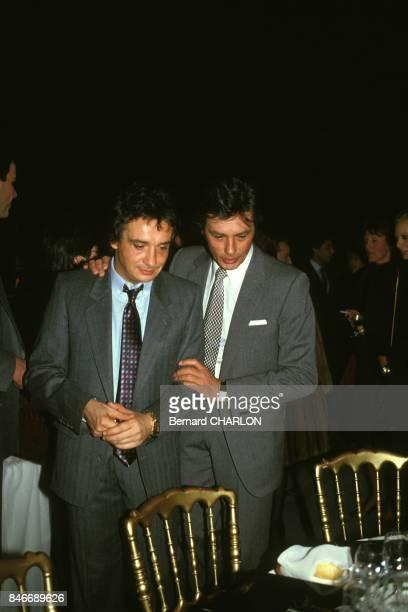 Michel Sardou avec Alain Delon apres la premiere de son spectacle au Palais des Congres le 19 janvier 1983 a Paris France