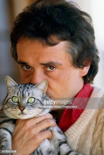 Michel Sardou Holding Silver Cat