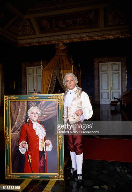 Michel Serrault wears his costume and poses with a portrait on the set of the French film Liberte Egalite Choucroute or Liberty Equality Sauerkraut...