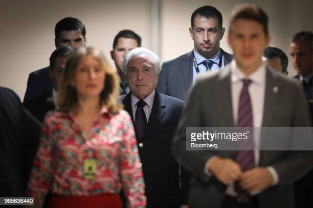 Michel Temer Brazil's president center leaves after speaking at a press conference on the resignation of Petroleos Brasileiros SA chief executive...