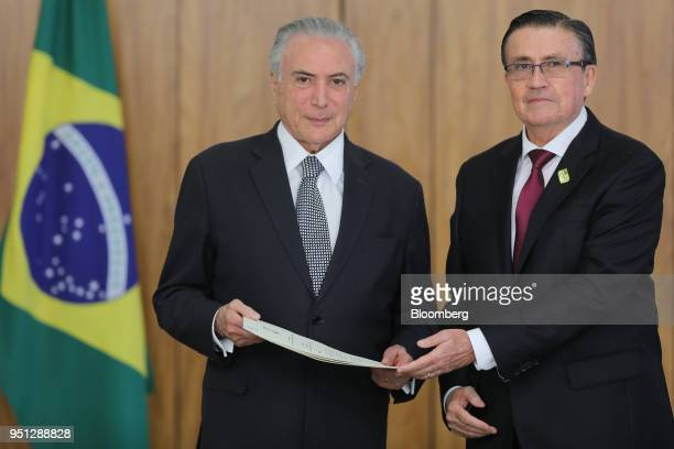 Michel Temer Brazil's president left and Diego Antonio Rivadeneira Espinosa Ecuador's ambassador to Brazil stand for a photograph during a ceremony...