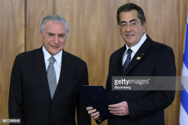 Michel Temer Brazil's president left and Ioannis Pediotis Greece's ambassador to Brazil stand for a photograph during a ceremony of accreditation at...