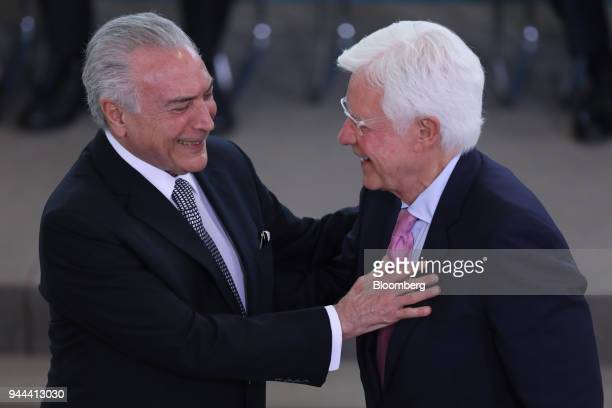 Michel Temer Brazil's president left greets Wellington Moreira Franco Brazil's mines and energy minister during a swearing in ceremony at the...