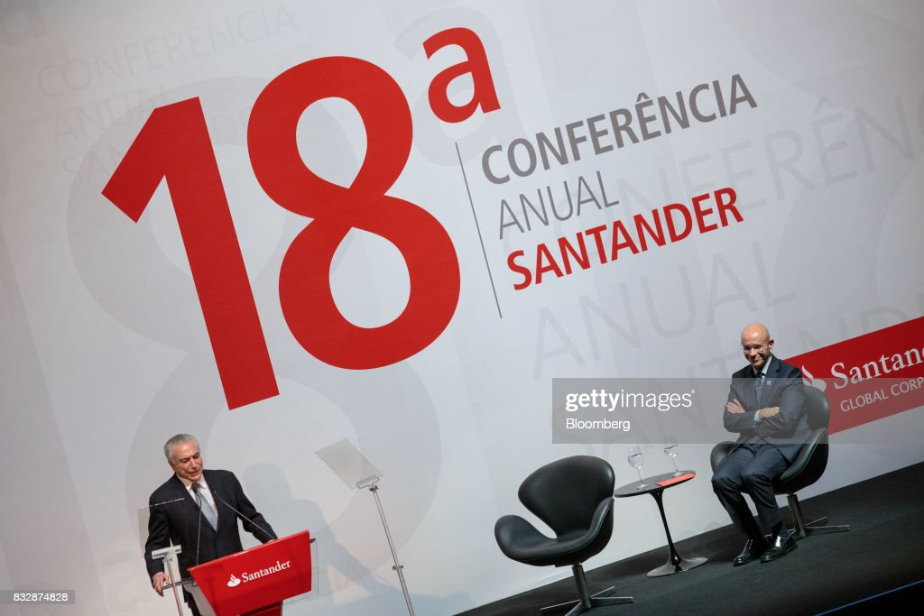 Michel Temer, Brazil's president, left, speaks while Sergio Rial, chief executive officer for Banco Santander Brasil SA, listens during the Annual Santander Conference in Sao Paulo, Brazil, on Wednesday, Aug. 16, 2017. Temer announced that he will travel to China at the end of the month to meet with the business community as interest in investing in Brazil grows. Photographer: Patricia Monteiro/Bloomberg via Getty Images