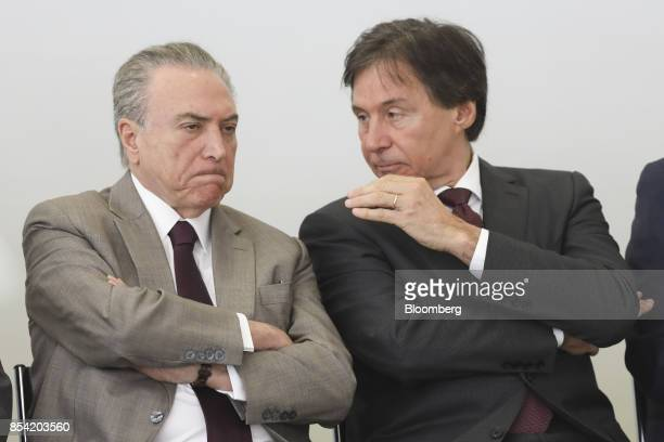 Michel Temer Brazil's president left speaks with Eunicio Oliveira president of Brazil's senate during the launch event of the Progredir program which...