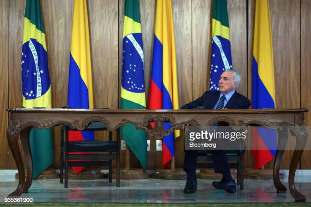 Michel Temer Brazil's president listens during a joint press conference with Juan Manuel Santos Colombia's president not pictured at the Planalto...