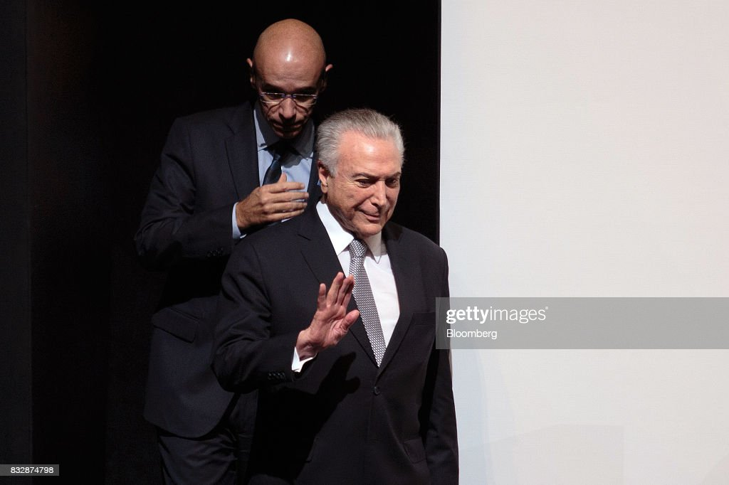 Michel Temer, Brazil's president, right, and Sergio Rial, chief executive officer for Banco Santander Brasil SA, arrive on stage during the Annual Santander Conference in Sao Paulo, Brazil, on Wednesday, Aug. 16, 2017. Temer announced that he will travel to China at the end of the month to meet with the business community as interest in investing in Brazil grows. Photographer: Patricia Monteiro/Bloomberg via Getty Images