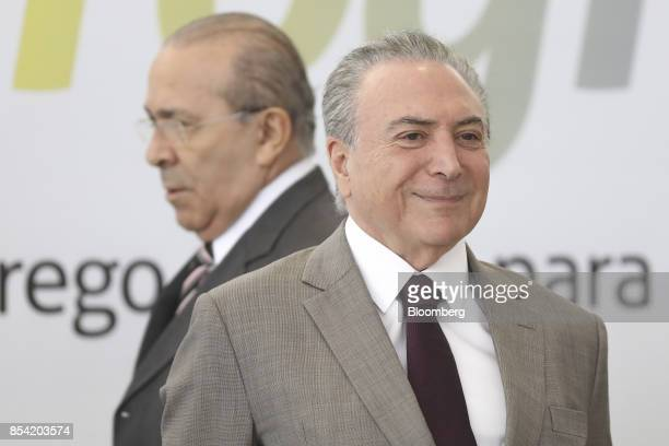 Michel Temer Brazil's president right stands in front of EliseuPadilha Brazil's chief of staff while arriving on stage during the launch event of...
