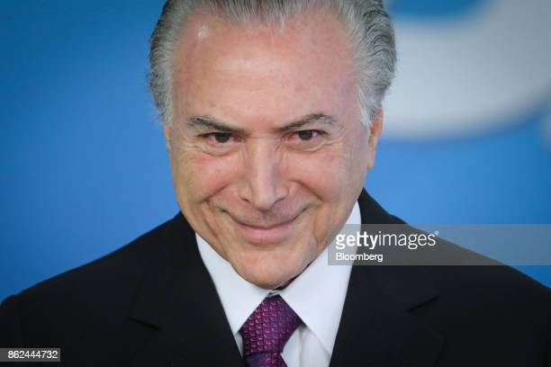 Michel Temer Brazil's president smiles during the Medal of Medical Merit ceremony at the Planalto Palace in Braslia Brazil on Tuesday Oct 17 2017...
