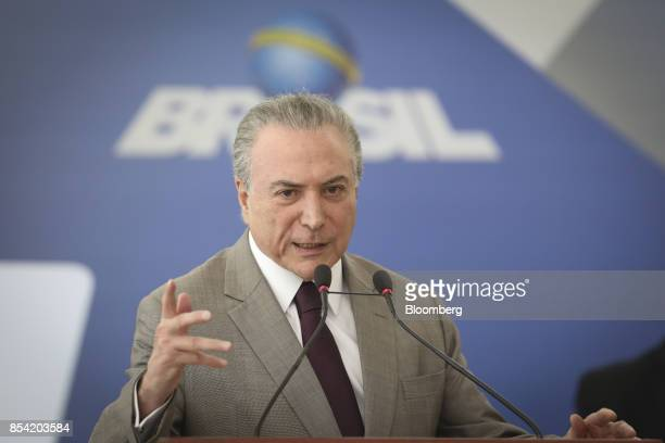 Michel Temer Brazil's president speaks during the launch event of the Progredir program which aims to offer micro credit at the Planalto Palace in...