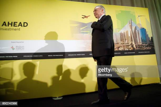 Michel Temer Brazil's president walks on stage to speak during the Brazil The Road Ahead event in New York US on Wednesday Sept 20 2017 The Brazil...