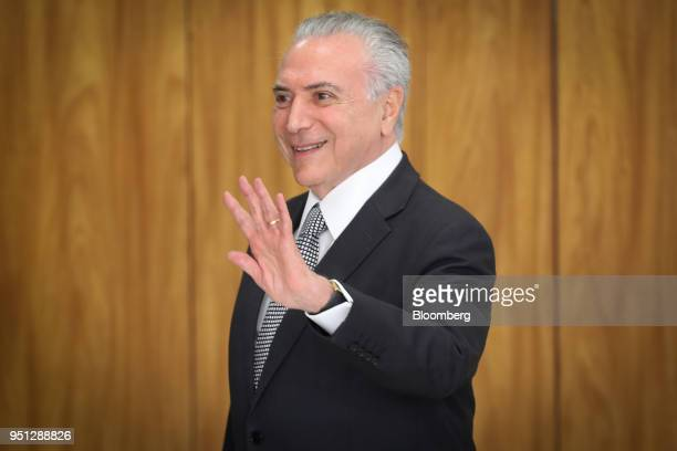 Michel Temer Brazil's president waves while leaving a ceremony of accreditation at the Planalto Palace in Brasilia Brazil on Wednesday April 25 2018...