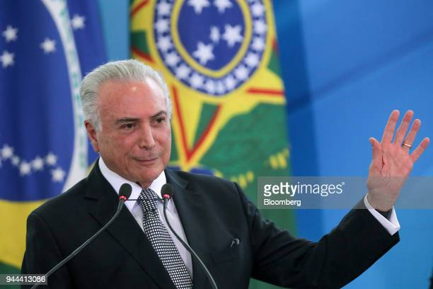 Michel Temer Brazil's president waves while speaking during a swearing in ceremony at the Planalto Palace in Brasilia Brazil on Tuesday April 10 2018...