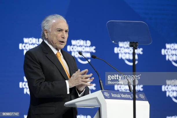 Michel Temer president of Brazil gestures as he speaks during a special address on day two of the World Economic Forum in Davos Switzerland on...