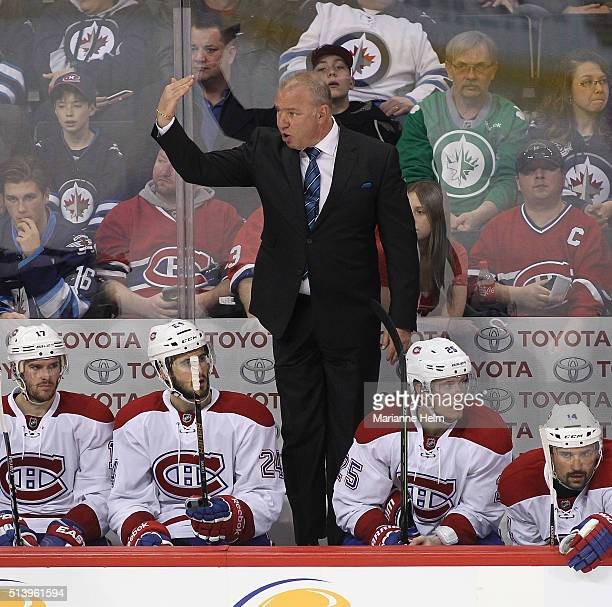 Michel Therrien head coach of the Montreal Canadiens gestures to goaltender Mike Condon from the bench in third period action in an NHL game against...