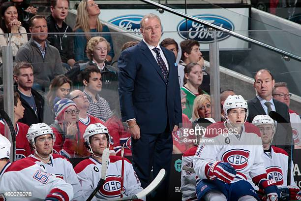 Michel Therrien head coach of the Montreal Canadiens looks on from the bench against the Dallas Stars at the American Airlines Center on December 6...