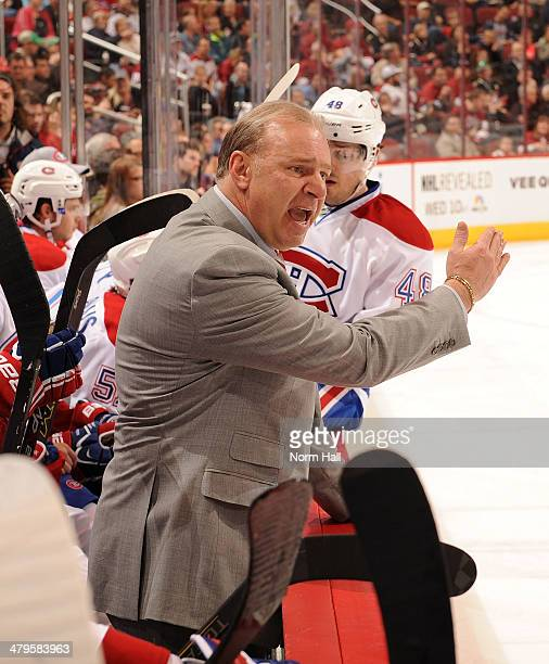Michel Therrien Head Coach of the Montreal Canadiens yells at his players on the ice during a stop in play against the Phoenix Coyotes at Jobingcom...