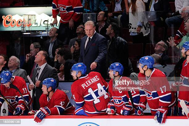 Michel Therrien of the Montreal Canadiens speaks to players during the NHL game against the Toronto Maple Leafs at the Bell Centre on October 1 2013...