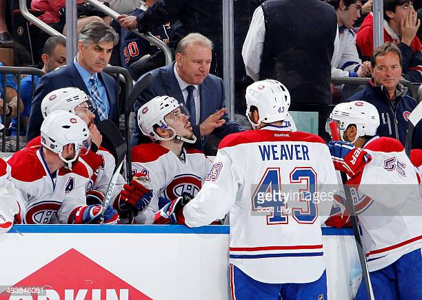 Michel Therrien of the Montreal Canadiens talks to members of his team in the third period of Game Four of the Eastern Conference Final against the...