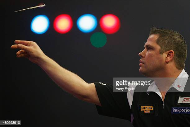 Michel Van Der Horst of the Netherlands throws during his Preliminary Round match against David Cameron of Canada on day one of the BDO Lakeside...