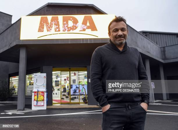 Michel Vieira CEO of the MDA Domestic electrical goods poses for photographs outside one of his stores on December 21 2017 in Lozanne near Lyon...