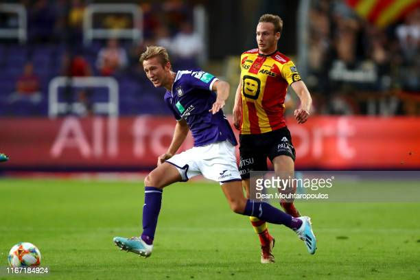 Michel Vlap of Anderlecht battles for the ball with Alexander Corryn of KV Mechelen during the Jupiler Pro League match between RSCA or Royal...
