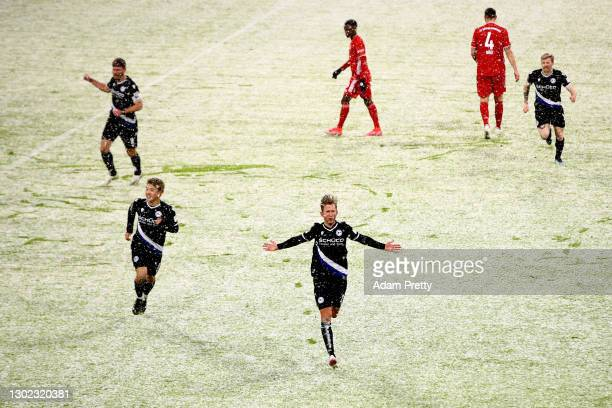 Michel Vlap of Arminia Bielefeld celebrates after scoring their team's first goal during the Bundesliga match between FC Bayern Muenchen and DSC...